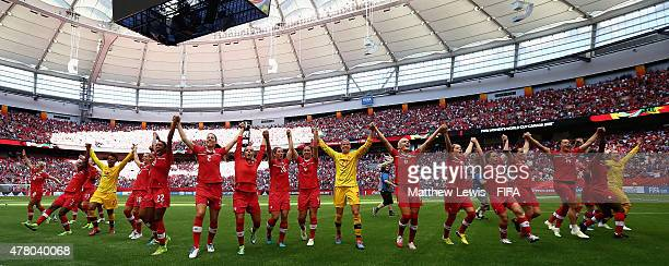 Canada celebrate their win over Switzerland after the FIFA Women's World Cup 2015 Round of 16 match between Canada and Switzerland at BC Place...