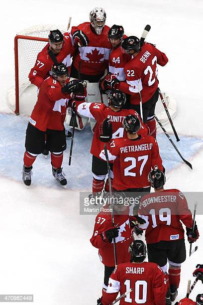 Canada celebrates after defeating the United States 10 during the Men's Ice Hockey Semifinal Playoff on Day 14 of the 2014 Sochi Winter Olympics at...