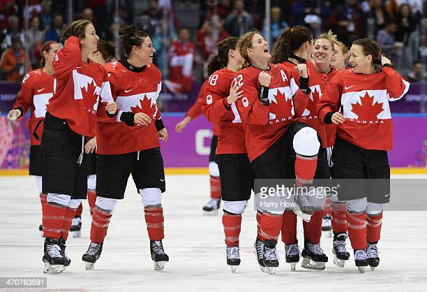 Canada celebrates after Marie-Philip Poulin scored the game-winning goal against the United States in overtime during the Ice Hockey Women's Gold...