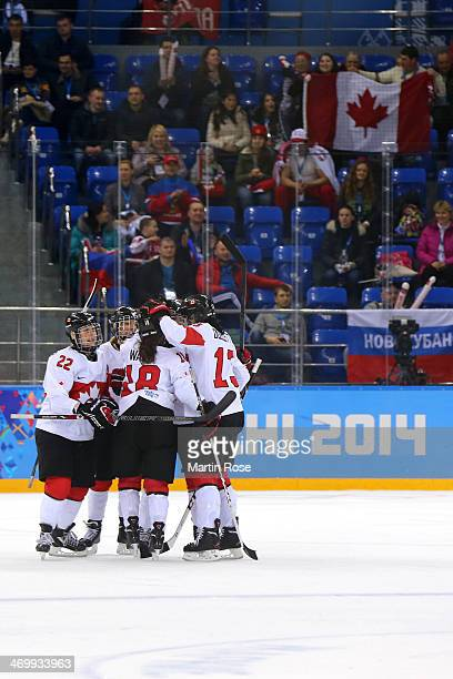 Canada celebrates after teammate Natalie Spooner scored a firstperiod goal against Switzerland during the Women's Ice Hockey Playoffs Semifinal game...