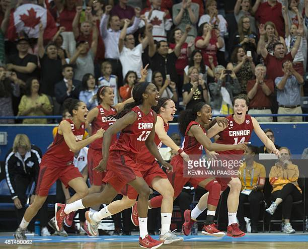 Canada celebrates after winning the gold over the US in the Women's Basketball gold medal game at the Pan American Games July 20 2015 in Toronto...