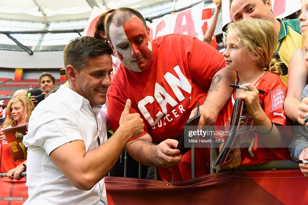 Canada coach John Herdman obliges a fan with a selfie after the FIFA Women's World Cup 2015 Round of 16 match between Canada and Switzerland at BC Place Stadium on June 21, 2015 in Vancouver, Canada.