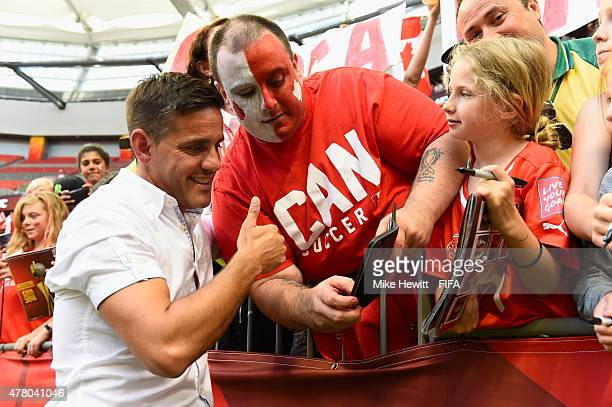 Canada coach John Herdman obliges a fan with a selfie after the FIFA Women's World Cup 2015 Round of 16 match between Canada and Switzerland at BC...