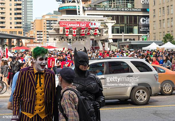 SQUARE TORONTO ONTARIO CANADA Canada Day celebrations in Toronto Busker performers Batman and Joker in Dundas Square