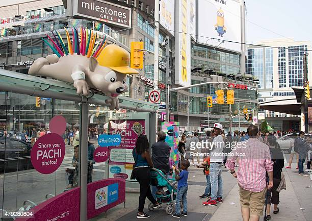 SQUARE TORONTO ONTARIO CANADA Canada Day celebrations in Toronto Pachi panam games mascott and people celebrating in Dundas Square