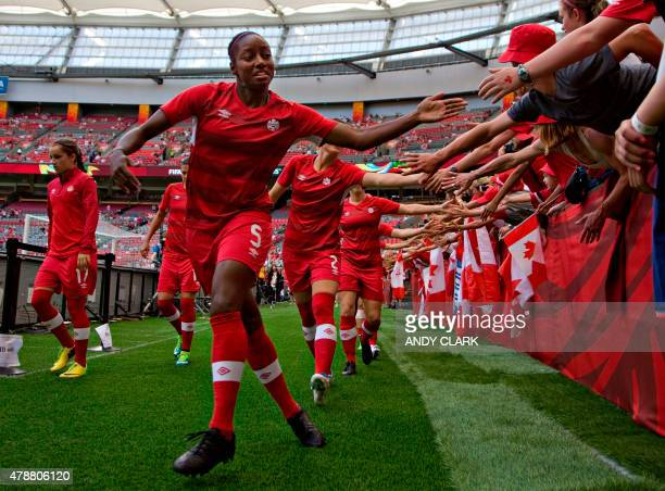 Canada defender Robyn Gayle greets fans prior to their quarterfinal football match against England during the 2015 FIFA Women's World Cup at BC Place...