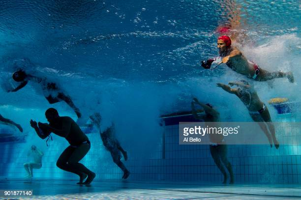 Canada enter the pool during the Men's Water Polo Group A preliminary round match between Brazil and Canada on day eight of the Budapest 2017 FINA...