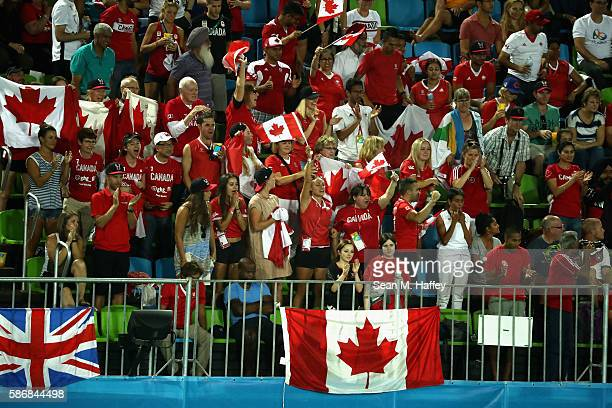 Canada fans react to a goal by Team Canada during a Men's Pool B match between Germany and Canada on Day 1 of the Rio 2016 Olympic Games at the...