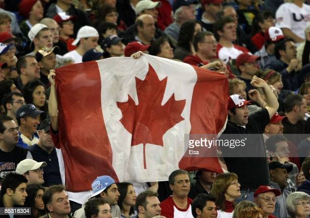 Canada fans wave the flag during the 2009 World Baseball Classic Pool C match on March 7, 2009 at the Rogers Center in Toronto, Ontario, Canada. The...