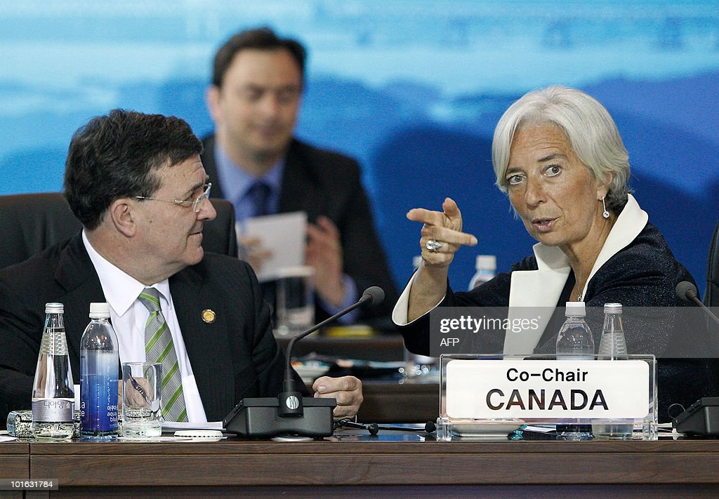 Canada Finance Minister James Flaherty (L) listens as his Frence counterpart Christine Lagarde (R) speaks at the G20 Finance Ministers and Central Bank Governors Meeting in Busan on June 5, 2010. Finance ministers from the world's leading nations sought to narrow differences on key banking reforms, wrapping up a two-day meeting aimed at safeguarding fragile economic recovery.