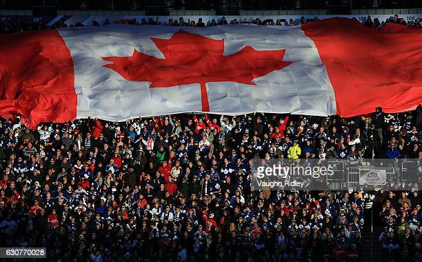 Canada flag is unfurled by fans prior to the 2017 Scotiabank NHL Centennial Classic between the Toronto Maple Leafs and the Detroit Red Wings at BMO...