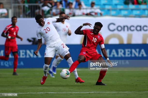 Canada forward Jonathan David and Cuba midfielder Aricheell Hernandez fight for the ballduring the 1st half of the CONCACAF Gold Cup game with Canada...