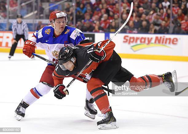Canada forward Mathieu Joseph collides with Russia forward Kirill Kaprizov in the second period during the World junior Hockey Championships on...