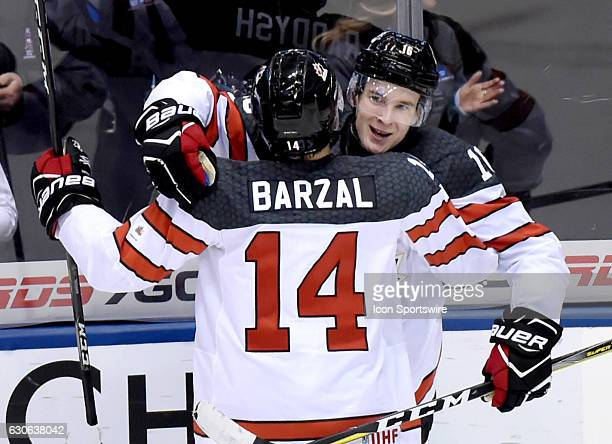 Canada forward Taylor Raddysh is congratulated by forward Matt Barzal after scoring against Slovakia during the Slovakia versus Canada game on...
