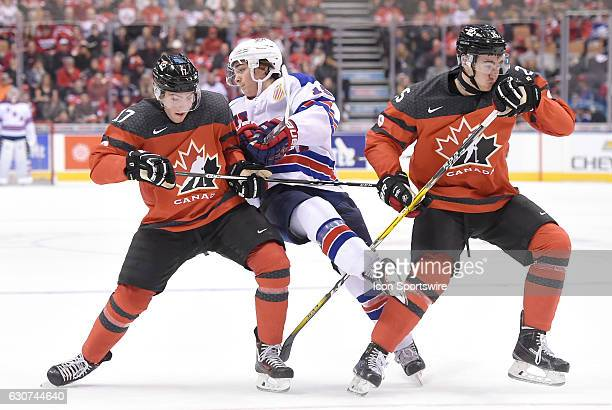 Canada forward Tyson Jost and defenceman Jeremy Lauzon team up to block USA forward Clayton Keller during the World Junior Hockey Championships on...