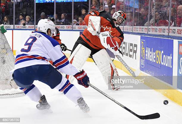 Canada goalie Connor Ingram clears the puck away from USA forward Luke Kunin in the first period at the World Junior Hockey Championships on December...