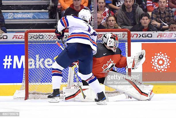 Canada goalie Connor Ingram makes a glove save on a shot by USA forward Joey Anderson during the World Junior Hockey Championships on December 31 at...