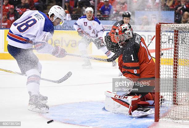 Canada goalie Connor Ingram makes a save on USA forward Colin White in the first period at the World Junior Hockey Championships on December 31 at...