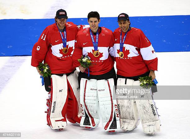 Canada goaltenders Mike Smith, Carey Price and Roberto Luongo of Canada pose with the gold medals won during the Men's Ice Hockey Gold Medal match...