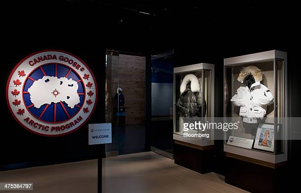 Canada Goose Inc signage is displayed at the entrance of the show room at the company's manufacturing facility in Toronto Ontario Canada on Thursday...