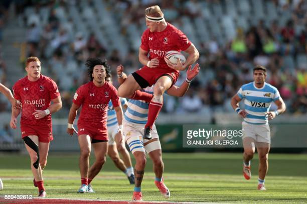 Canada John Moonlight jumps for the ball during the semifinal Argentina vs Canada during the second day of the World Rugby Sevens Series at Cape Town...