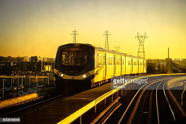 Canada Line Running Through Richmond and Vancouver City at Sunset