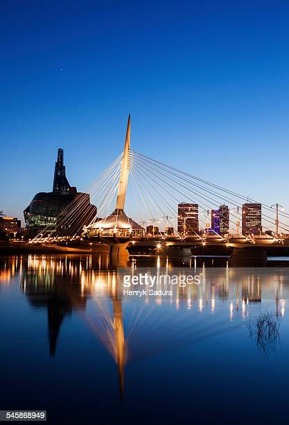 Canada, Manitoba, Winnipeg, Canadian Museum for Human Rights and Esplanade Riel bridge at dusk