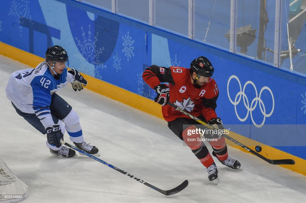 Canada men's hockey forward Andrew Ebbett (19) and Finland men's hockey defender Heiskanen Miro (42) chase a loose puck during the men's hockey semi final game between Canada and Finland during the 2018 Winter Olympic Games at the Gangneung Hockey Center on February 21, 2018 in PyeongChang, South Korea. Canada advances to the gold medal game with 1-0 victory.