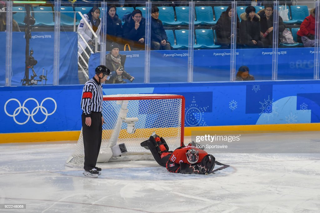 Canada men's hockey goalie Ben Scrivens (30) is face down on the ice after taking a heavy hit during second period action during the men's hockey semi final game between Canada and Finland during the 2018 Winter Olympic Games at the Gangneung Hockey Center on February 21, 2018 in PyeongChang, South Korea. Canada advances to the gold medal game with 1-0 victory.