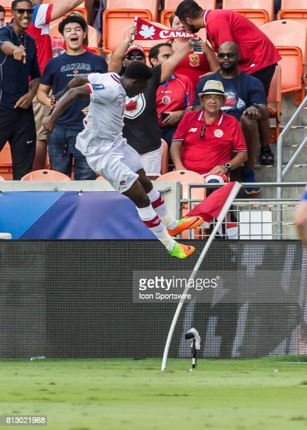 Canada midfielder Alphonso Davies kicks the corner flag in celebration of his scored goal during the CONCACAF Gold Cup Group A match between Costa...
