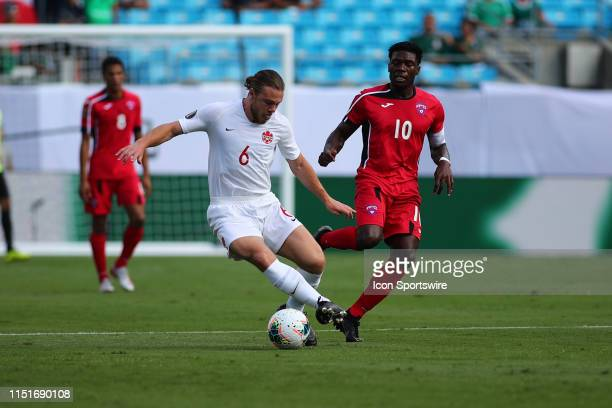 Canada midfielder Samuel Piette with the ball with Cuba midfielder Aricheell Hernandez behind him during the 1st half of the CONCACAF Gold Cup game...