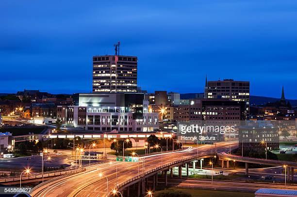 Canada, New Brunswick, St John, Illuminated overcrossing in city at dusk