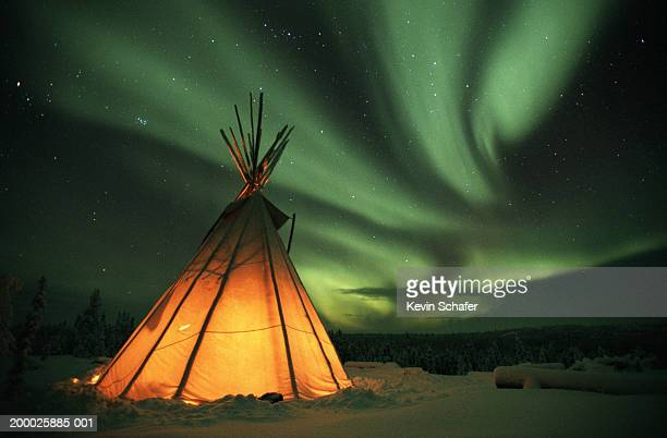 canada, northern lights (aurora borealis) - teepee stock pictures, royalty-free photos & images