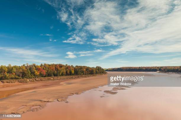 canada, nova scotia, green oaks, fundy tidal interpretive area, elevated view of huge bay of fundy  tides on the shubenacadie river - east stock pictures, royalty-free photos & images