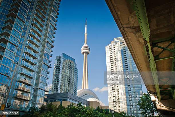 canada, ontario, toronto, low angle view of cn tower and skyscrapers - cn tower stock pictures, royalty-free photos & images