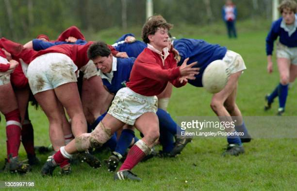 Canada player passes the ball out during play in the plate semi-final match between Canada and Italy in the 1991 Women's Rugby World Cup tournament...