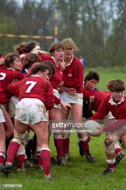 Canada player prepares to pass the ball out during play in the plate semi-final match between Canada and Italy in the 1991 Women's Rugby World Cup...
