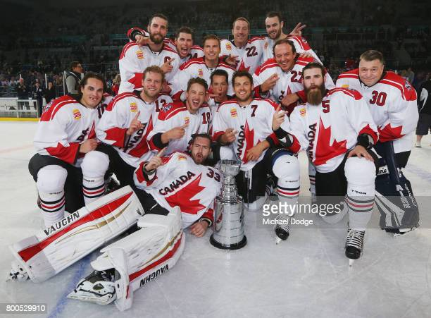 Canada players pose after winning the Ice Hockey Classic match and series between the United States of America and Canada at Hisense Arena on June...