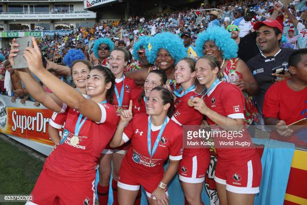 Canada players take a selfie as they celebrate victory with the crowd after victory during the womens cup final match between USA and Canada in the...