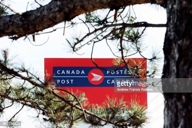 Canada Post Gateway building sign framed by tree at the corner of Eglinton Ave. E. And Dixie Rd. In Mississauga. The federal Liberals will spell out...