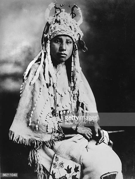 Canada Pretty face girl of a iroquois chief Dress in skin of roedeer decorated with shells Hairstyle of hermine pearls and little spherical bells 1927
