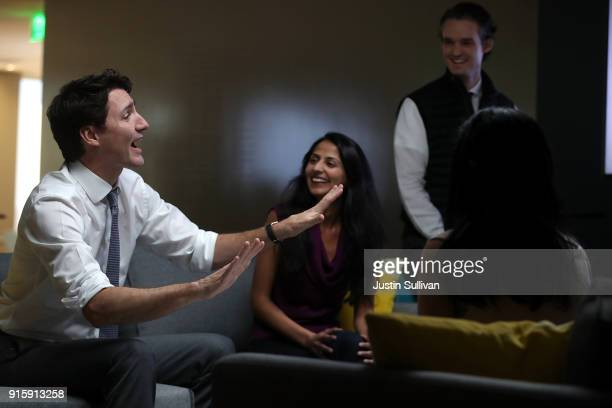 Canada Prime Minister Justin Trudeau talks with employees at AppDirect during a visit to the company on February 8 2018 in San Francisco California...
