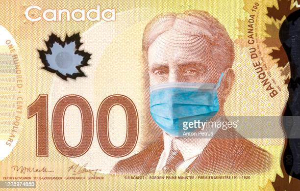 canada quarantine. 100 canadian dollar banknote with medical mask. the concept of epidemic and protection against coronavrius. - canadian one hundred dollar bill stock pictures, royalty-free photos & images