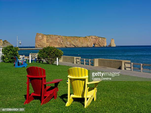 Canada, Quebec, Gaspesie, Perce Rock, two Adirondack chairs on lawn