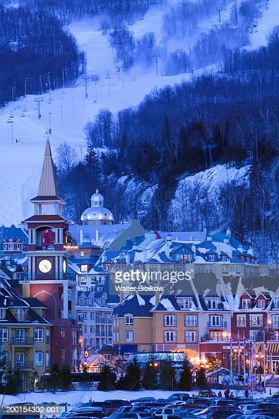 canada, quebec, mont tremblant ski village, dusk - mont tremblant stock pictures, royalty-free photos & images