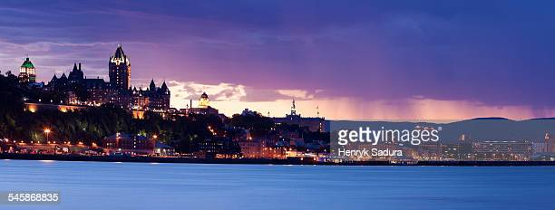 Canada, Quebec, Quebec City, Cityscape with river and mountains on background