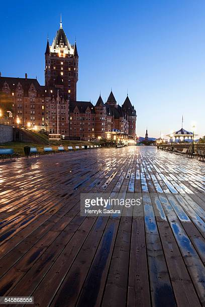 canada, quebec, quebec city, low angle view of wooden pier and illuminated - chateau frontenac hotel stock pictures, royalty-free photos & images