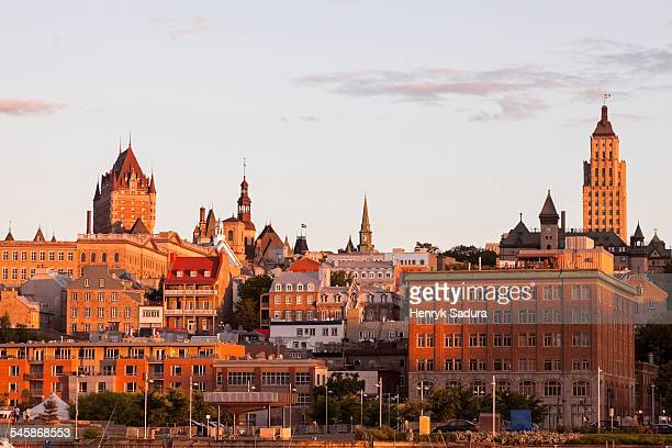 Canada, Quebec, Quebec City, View of old town architecture on hill at sunset