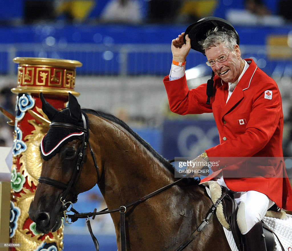Canada' s Ian Millar reacts after riding with 'In Style' during the Equestrian Jumping Individual competition of the 2008 Beijing Olympic Games in Hong Kong on August 18, 2008.