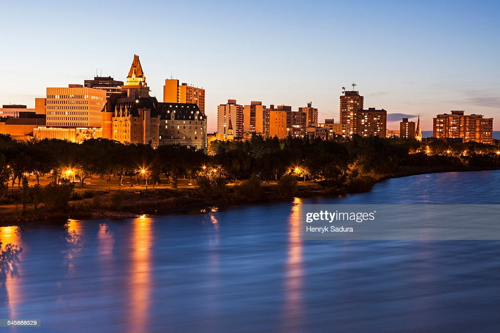 Canada, Saskatchewan, Saskatoon, Illuminated cityscape at dusk : Stock Photo